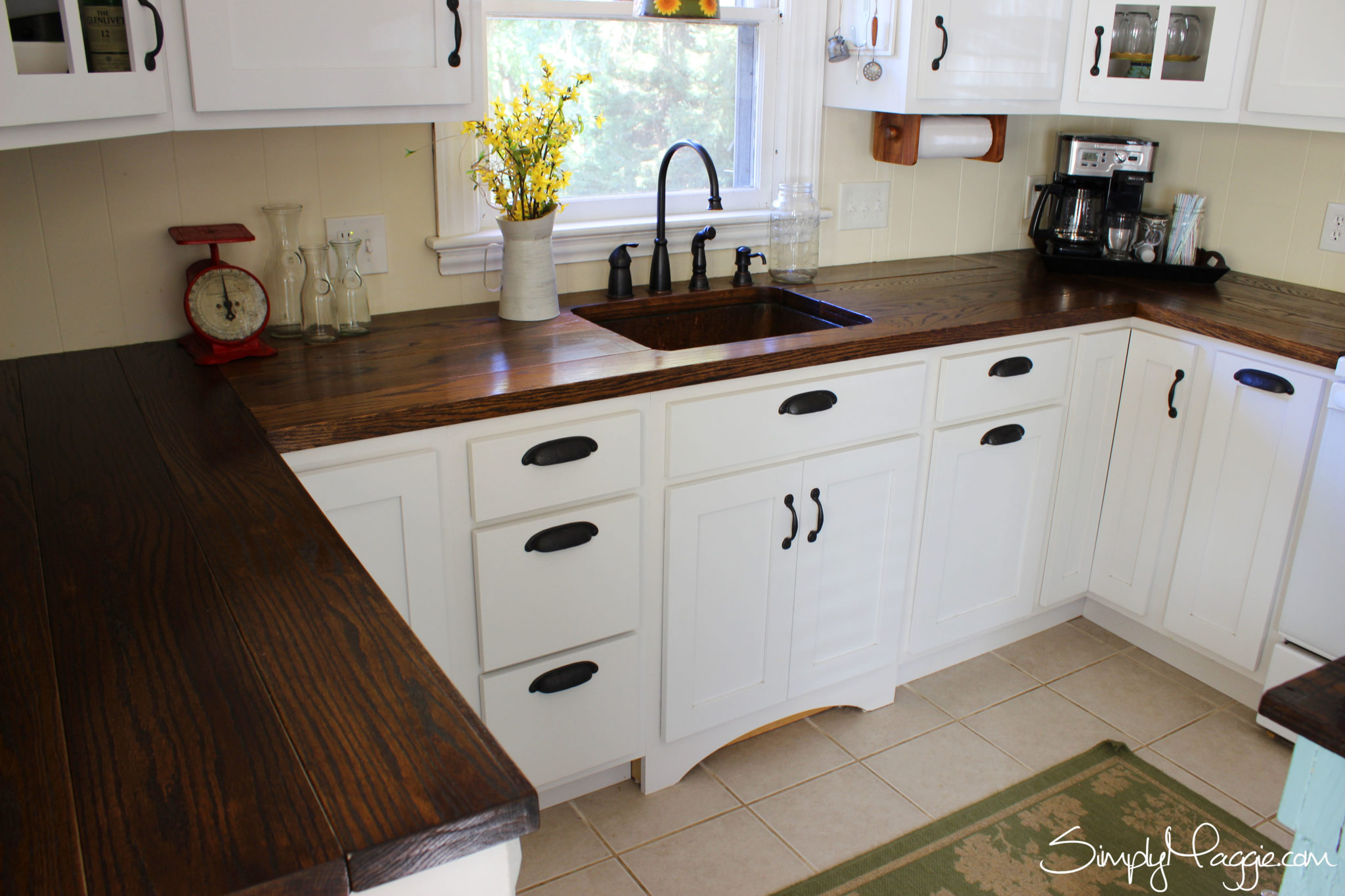 Charming and classy wooden kitchen countertops for Dark wood cabinets small kitchen
