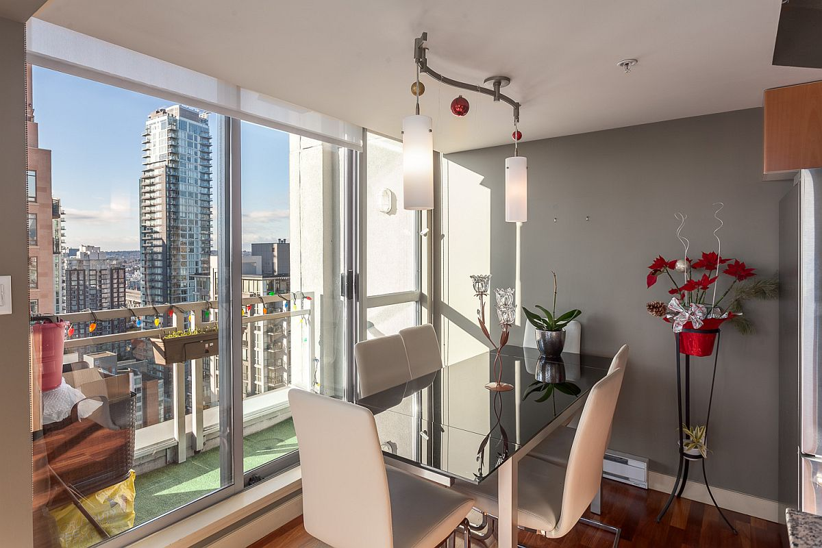 Dining room in gray with a view of Vancouver skyline
