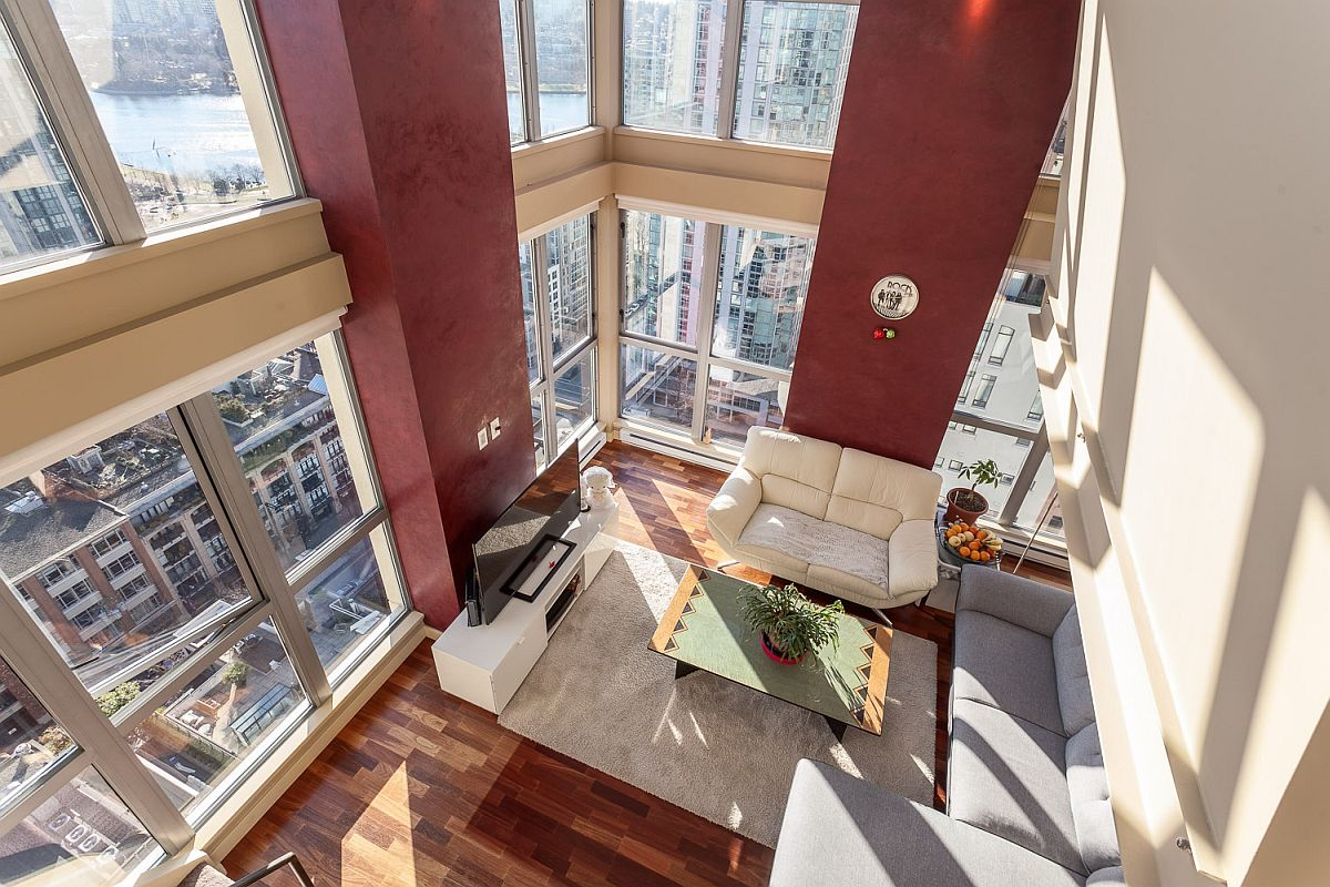 Doube height open living area with sweeping windows