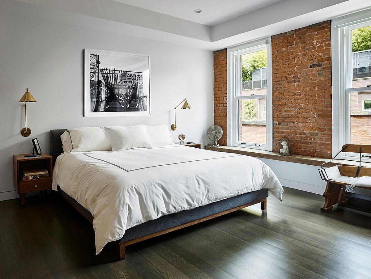 Exposed brick wall section of the bedroom