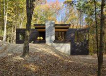 Exposed concrete and cedar shape the facade 217x155 Custom Charred Cedar Exterior Cloaks a Car Lover's Dream Retreat
