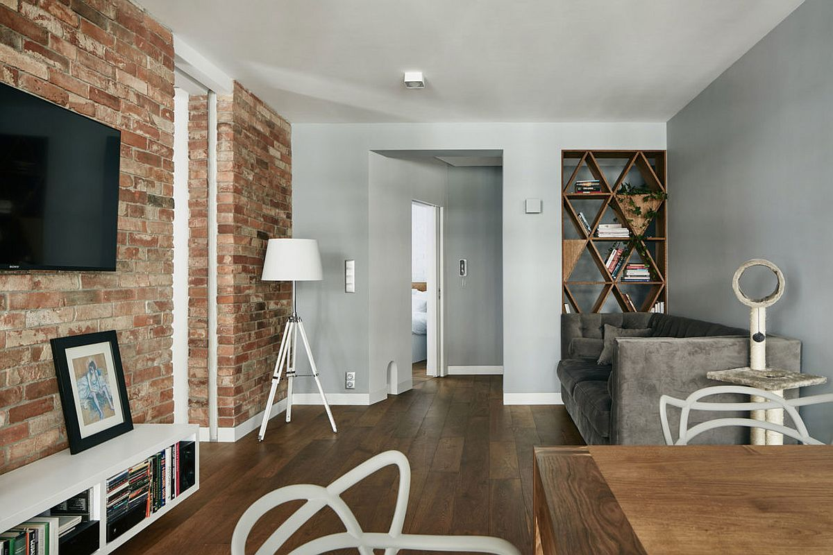 Exposed red brick walls for the living area Renovated Krakow Apartment Showcases Beauty of Exposed Brick Walls