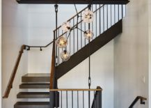 Exposed-wooden-beams-and-metallic-elements-inside-the-New-York-penthouse-217x155