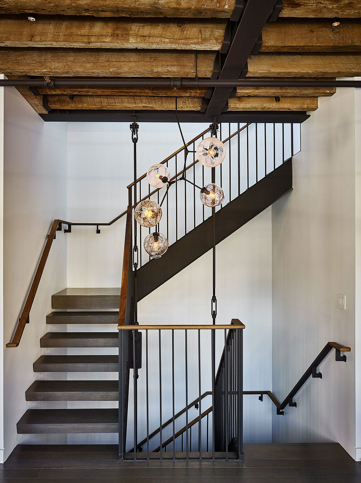 Exposed wooden beams and metallic elements inside the New York penthouse