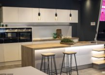 Fabulous-kitchen-in-whote-with-gray-backdrop-and-beautiful-lighting-217x155