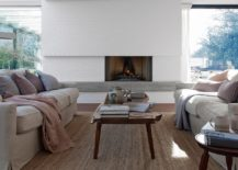 Fireplace with wall of glass windows next to it 217x155 Woodpeckers: Holiday Home in UK on the Edge of a Forest