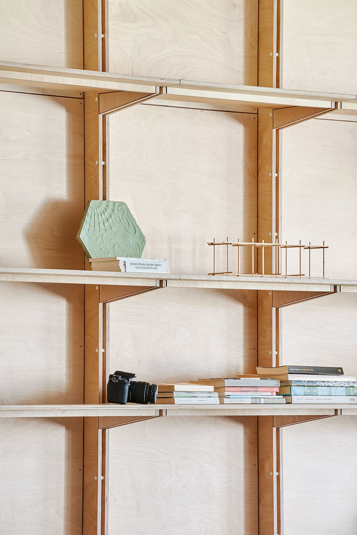 Floating shelves and timber walls offer modular ease