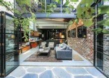 Folding doors connect the internal courtyard with the living space 217x155 Old Garage with Heritage Façade Finds New Life as a Fabulous Family Home