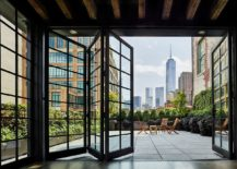 Folding framed glass doors give the New York pethouse industrial charm 217x155 Modern Industrial: 1890's New York apartment Turned into Exquisite Penthouse