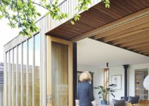 Folding glass doors connect the wooden box with the rear yard 217x155 Wooden Box House: Charming Extension Revamps Heritage Family Residence