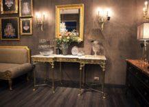 Frames-with-golden-glint-enliven-the-mundane-living-room-217x155