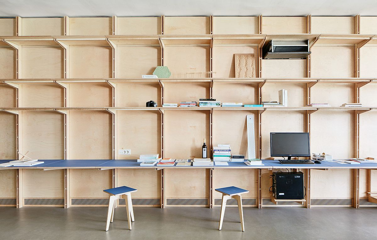 Furniture can be integrated into the timber wall with ease