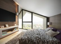 Gabled-roof-gives-the-bedroom-a-distinct-slanted-ceiling-217x155