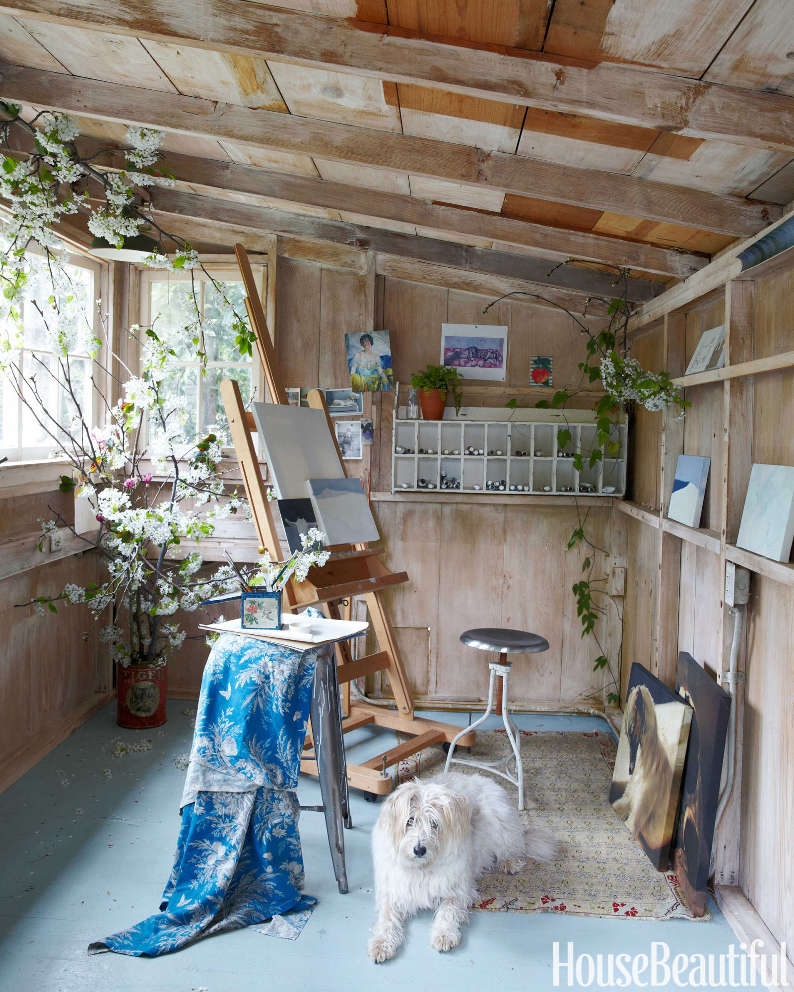 Garden shed art studio with neutral color palette