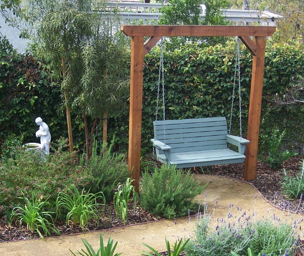 Garden swing with a pathway leading right up to it