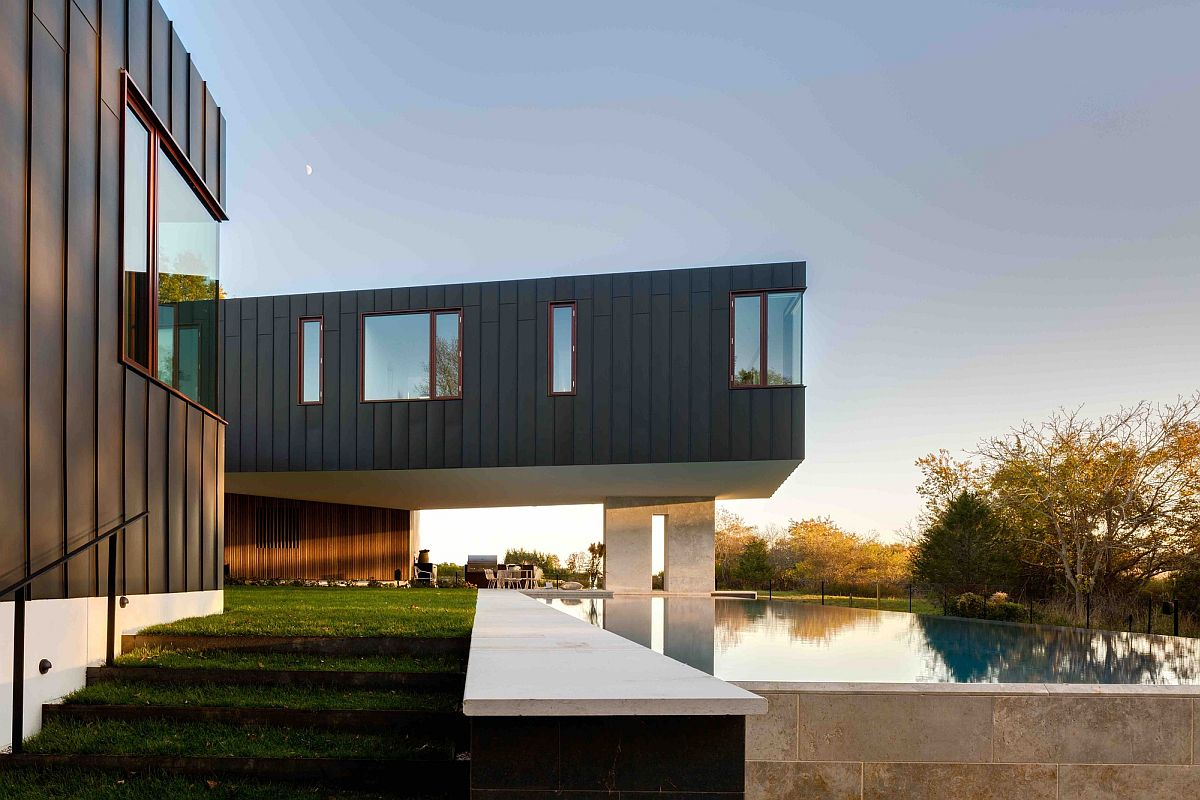 Gray exterior of the Long Island home overlooking the pool