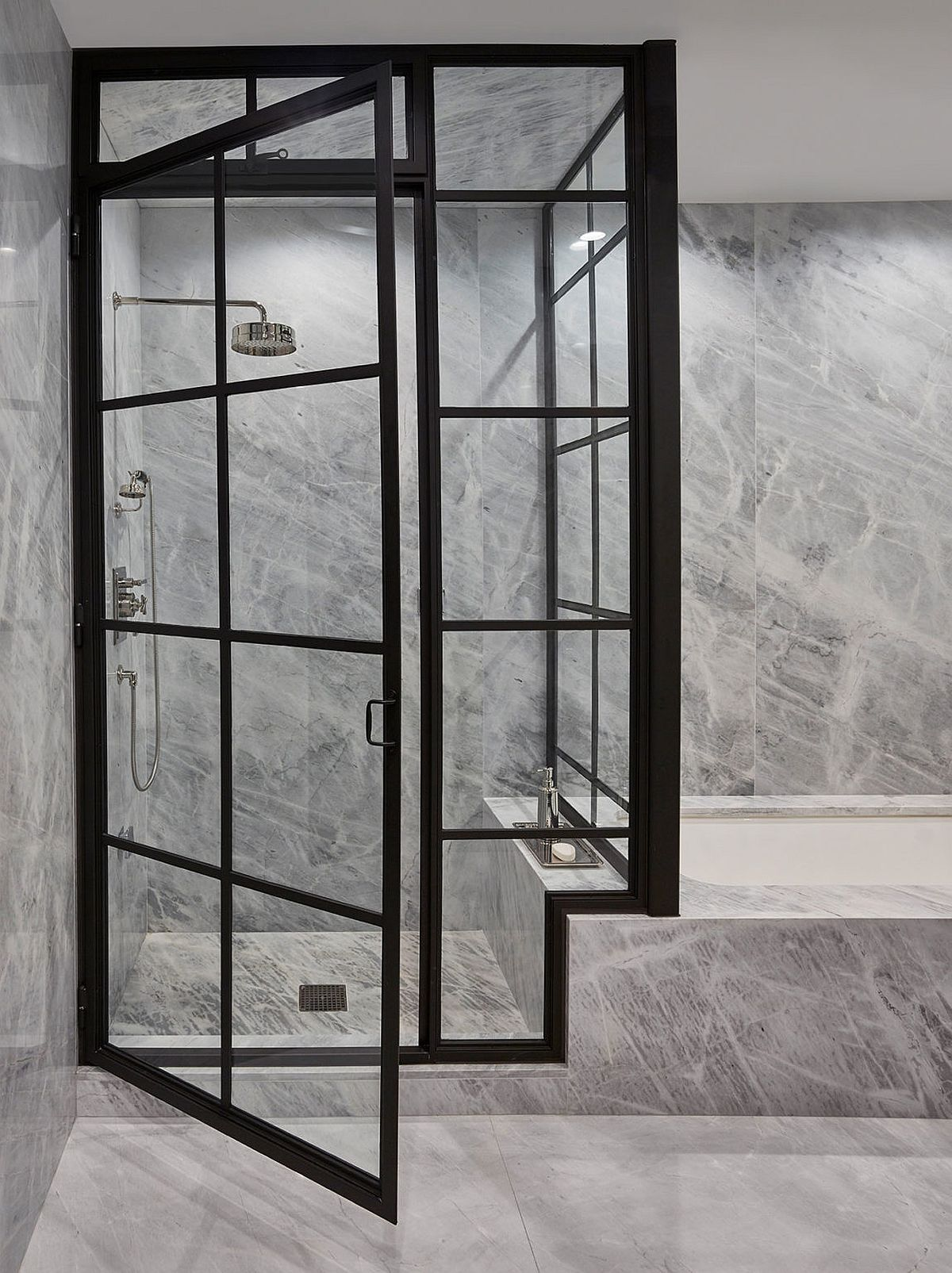 Gray stone and shower area of the penthouse bathroom