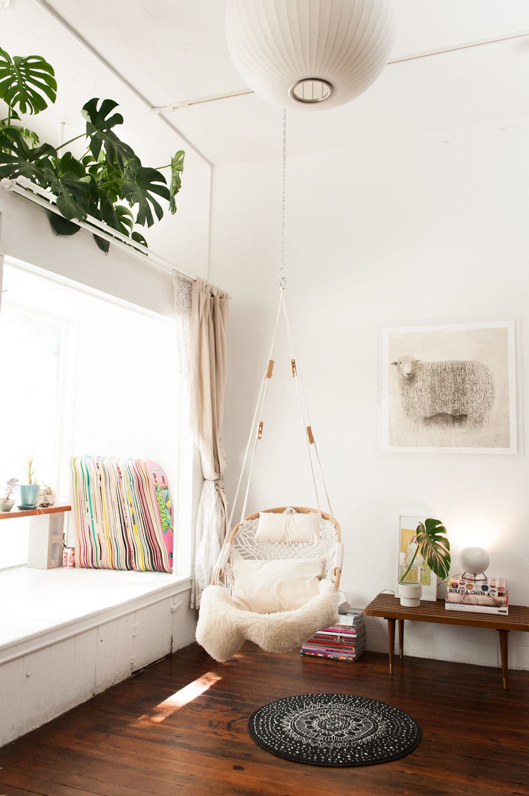 Hanging-chair-creates-a-contemporary-reading-nook-
