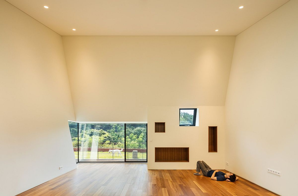 Etched into the landscape dramatic deep house with box for High ceiling interior