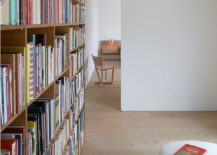 Home-library-with-shelf-that-also-helps-delineate-space-217x155
