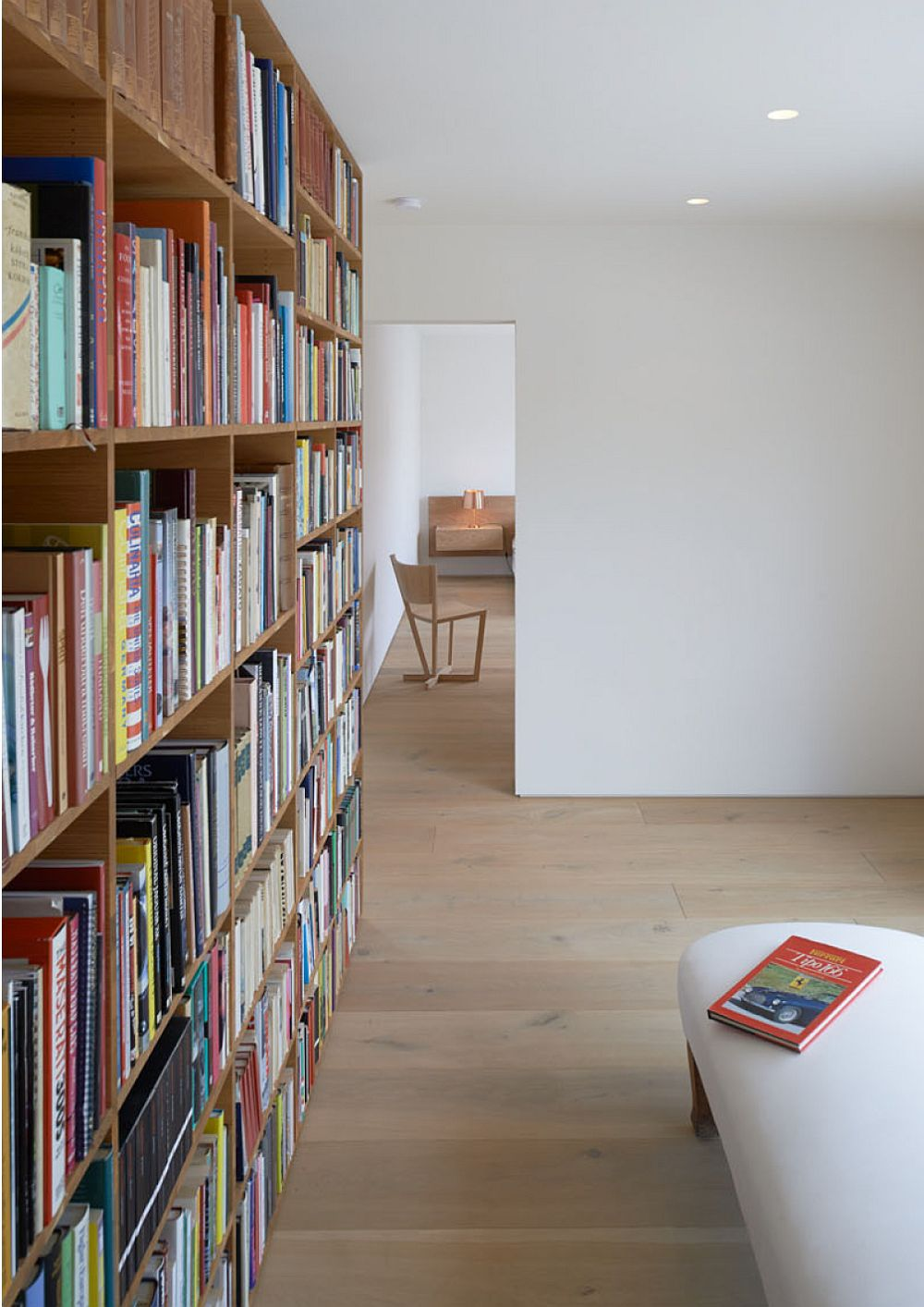 Home library with shelf that also helps delineate space