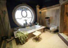 Huge-round-window-in-an-antique-bathroom-217x155