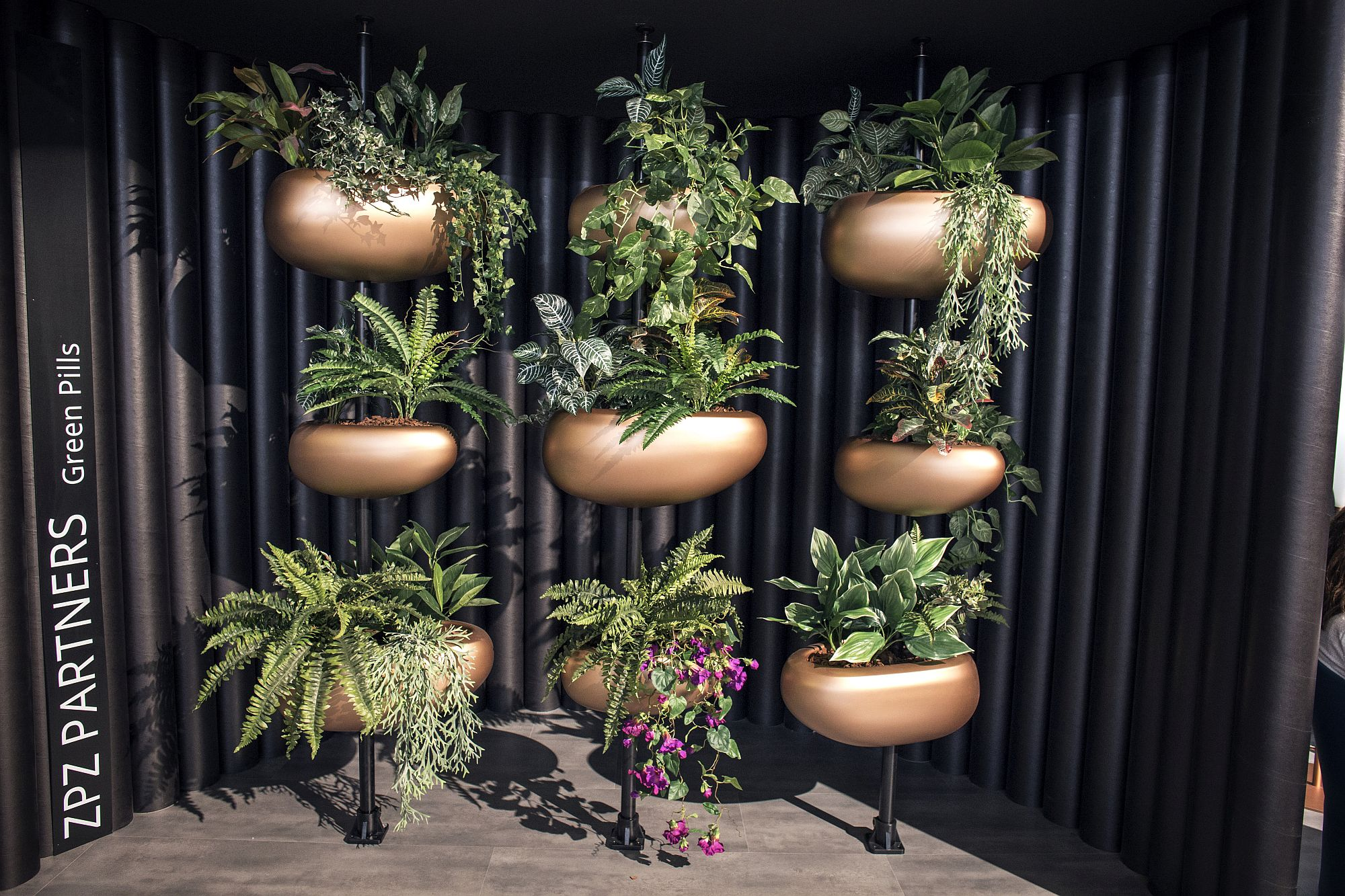 Innovative planters with metallic glint bring greenery to urban spaces