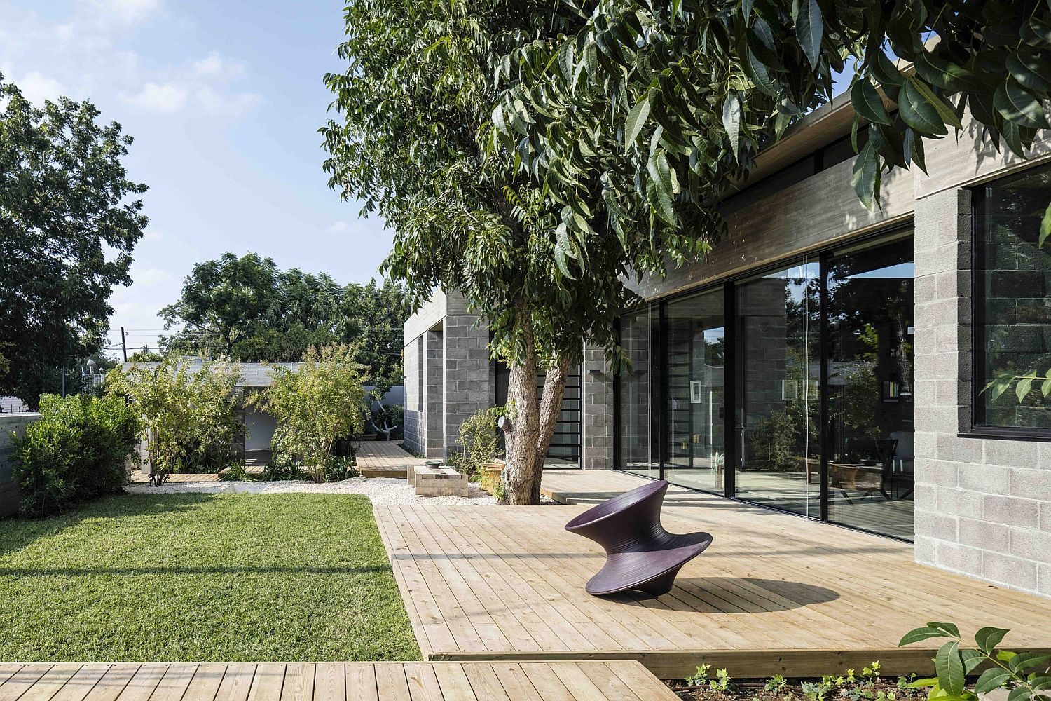 Inviting and private garden with wooden walkways