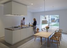 Kitchen-and-dining-area-in-white-connected-with-the-courtyard-217x155