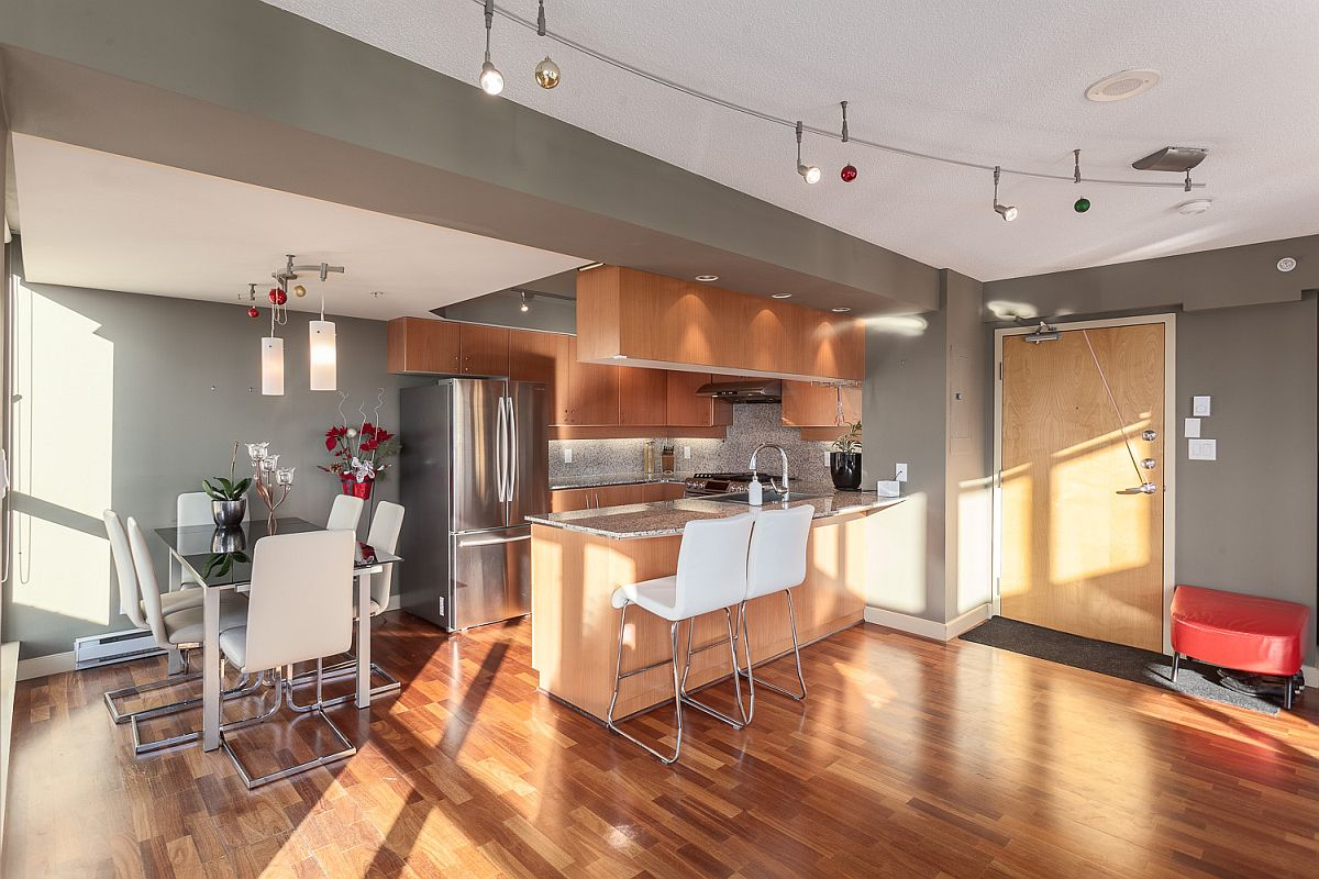 Kitchen and dining area with space-savvy modern sheen