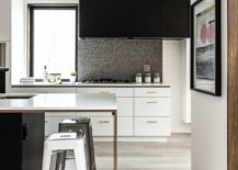 Kitchen-counter-and-workstation-in-white-with-dark-shelving-and-kitchen-island-217x155