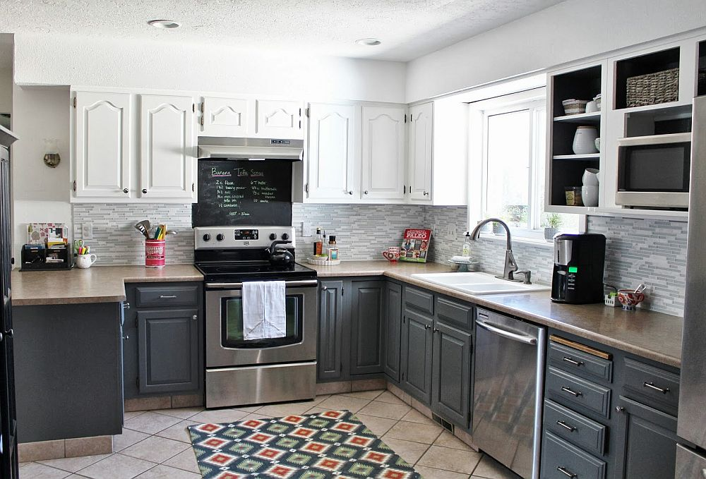 Kitchen in white with gray cabinets and a chalkboard wall section
