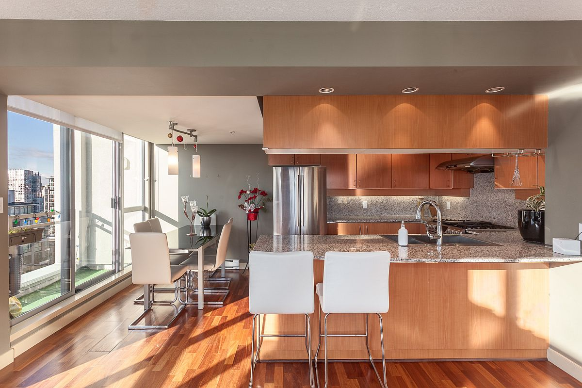 Kitchen with wooden cabinets, granite counters and stainless steel appliances