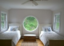 Large-round-window-makes-the-bedroom-open-and-breathable-217x155