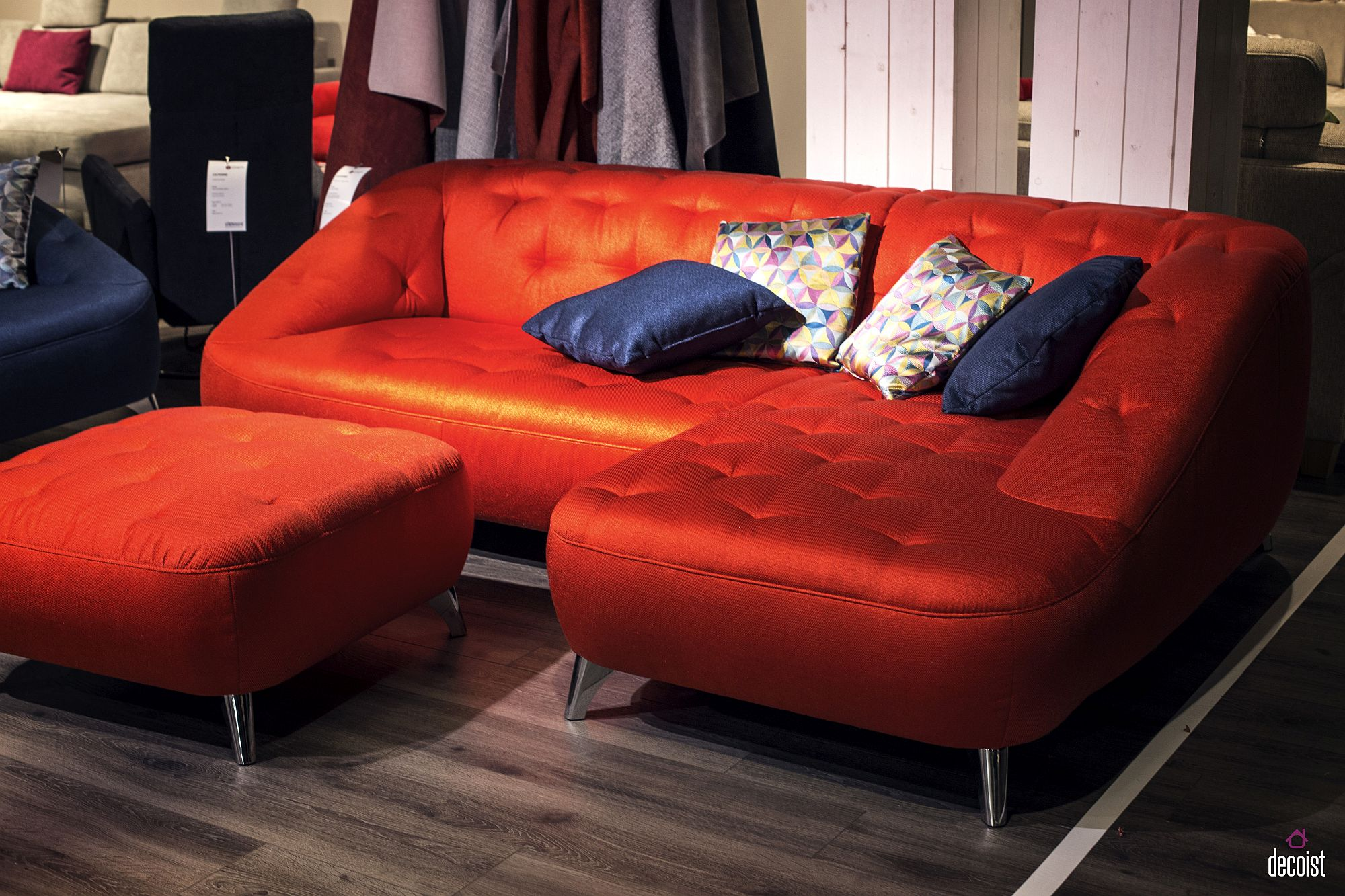 Matching ottoman adds to the comfort and class of the colorful couch
