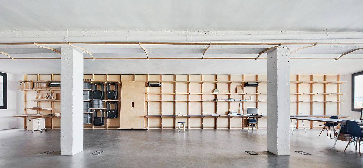 Milled timber multi-functional wall inside the modern industrial office