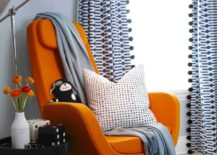Minimalist-reading-nook-with-a-vibrant-orange-chair--217x155