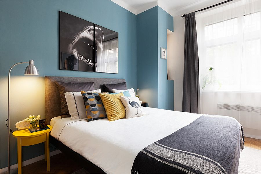 Modern bedroom in blue and white with pops of yellow