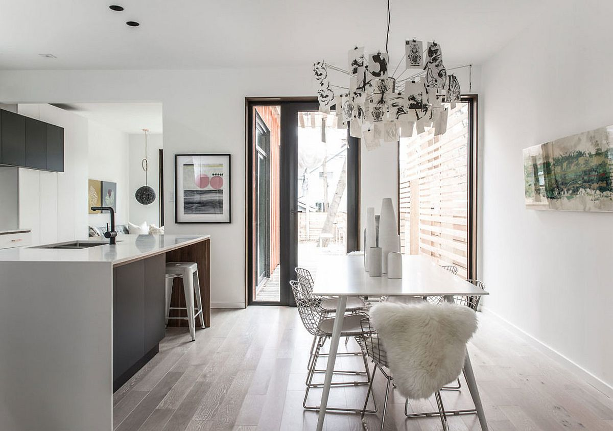 Modern kitchen in white and gray with wooden flooring
