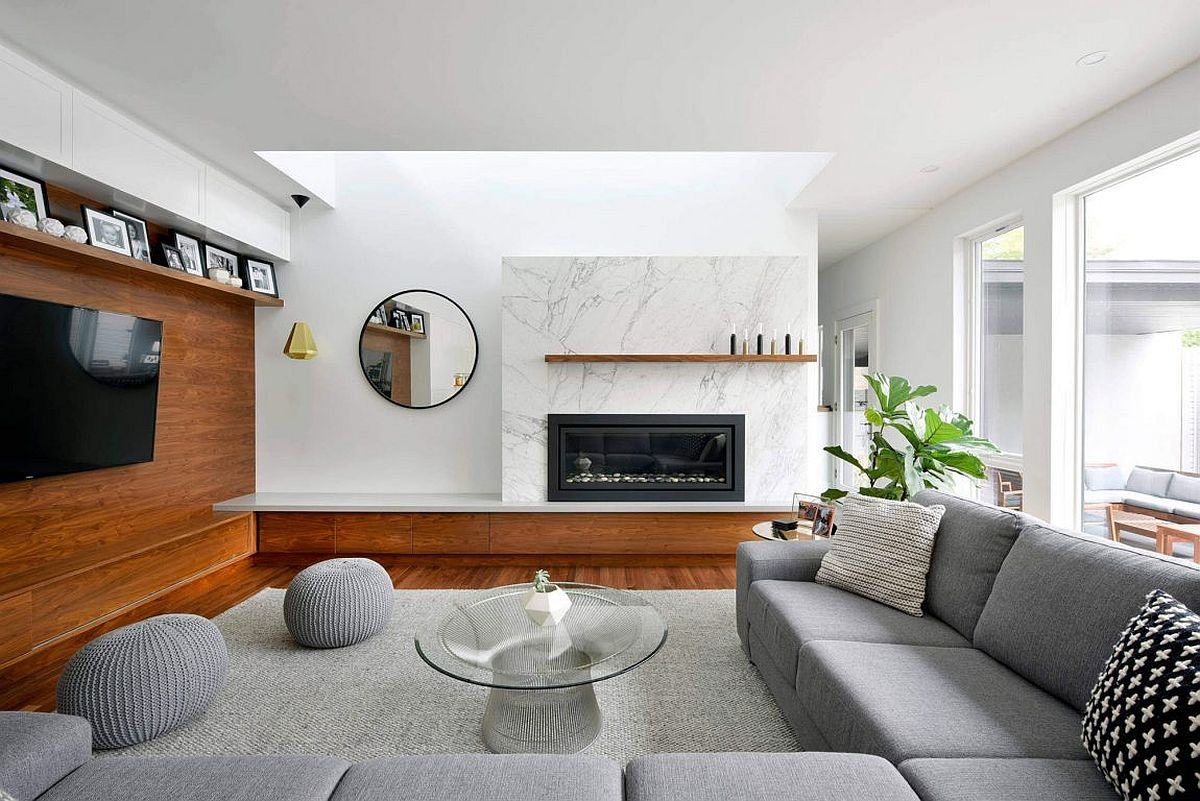 Modern living room with marble fireplace and wooden accent wall