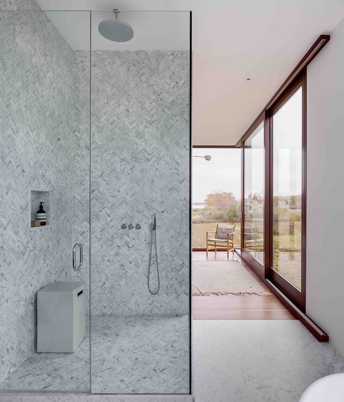 Modern master bedroom in white with corner shower area