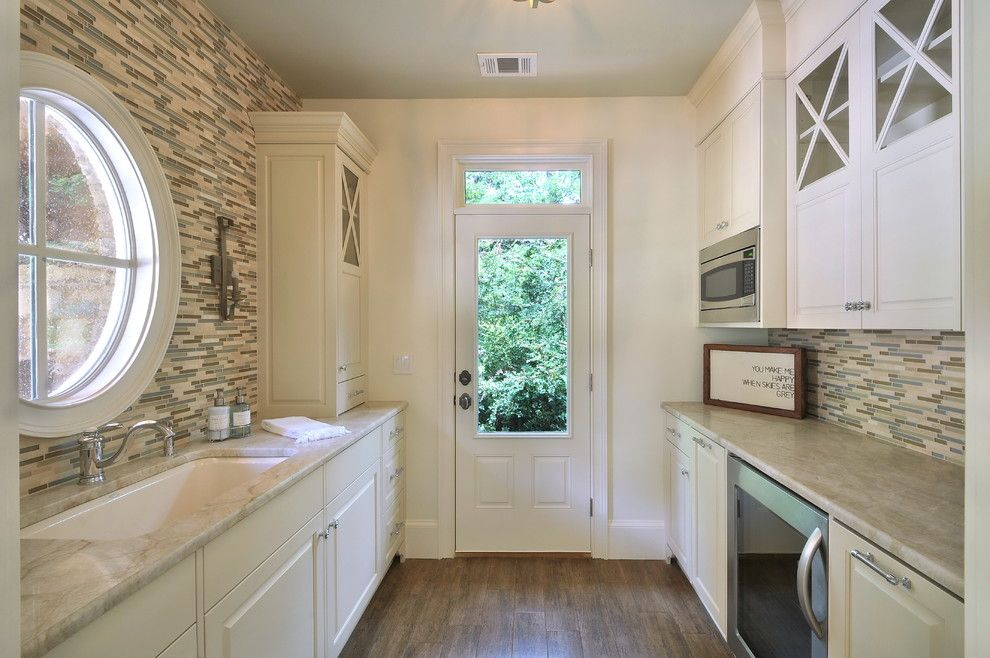 Narrow kitchen benefits from a round window