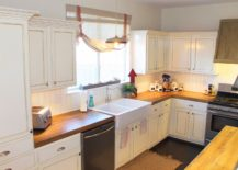 Narrow-white-kitchen-with-a-simplistic-wooden-countertop-217x155