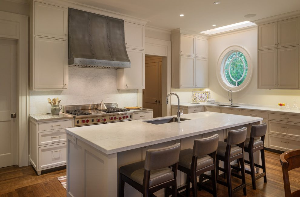 Neutral kitchen with a charming round window