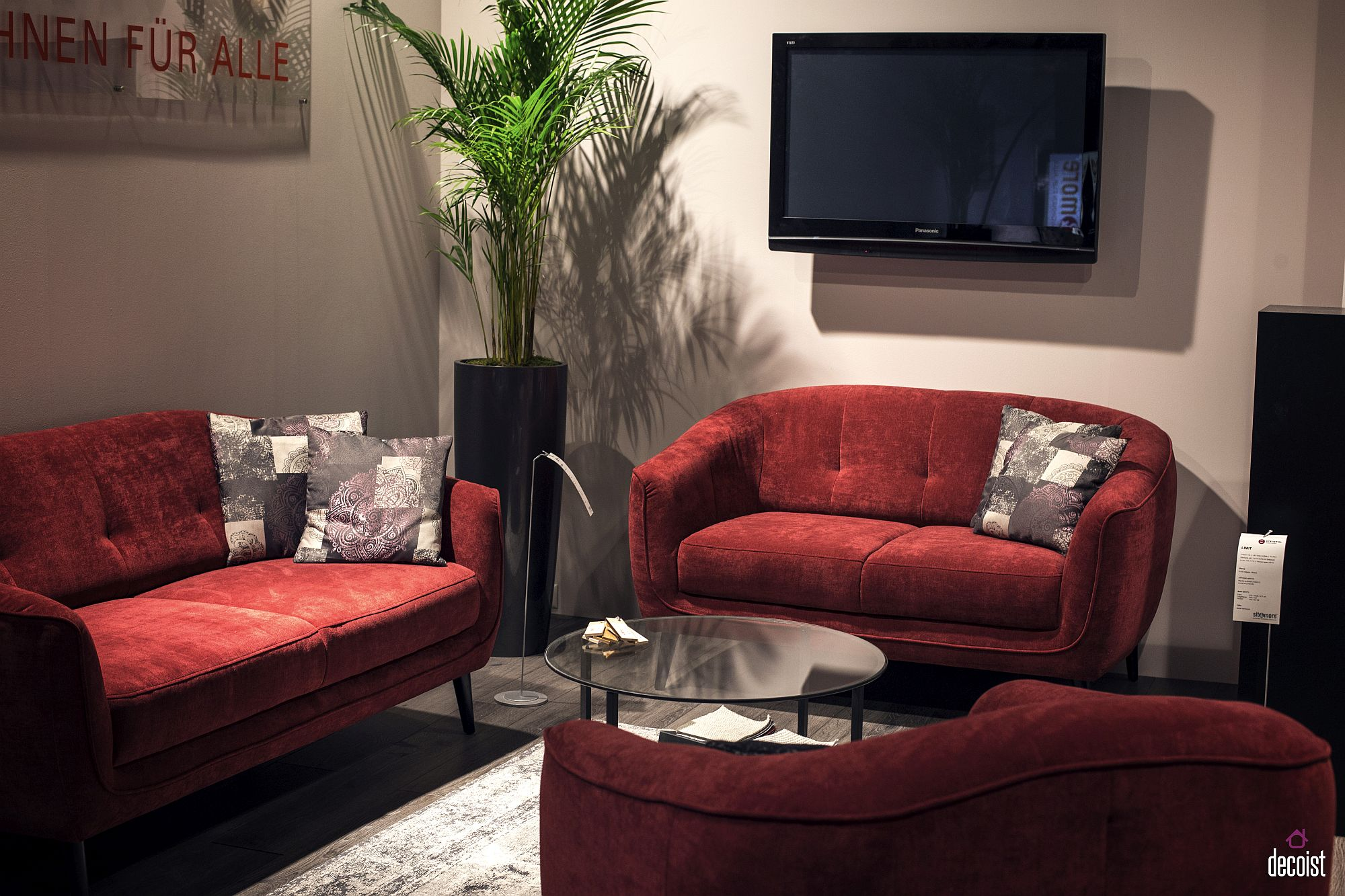Neutral living space with sofas in red