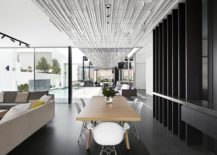 Open-dining-area-of-the-Aussie-home-with-a-dark-backdrop-217x155