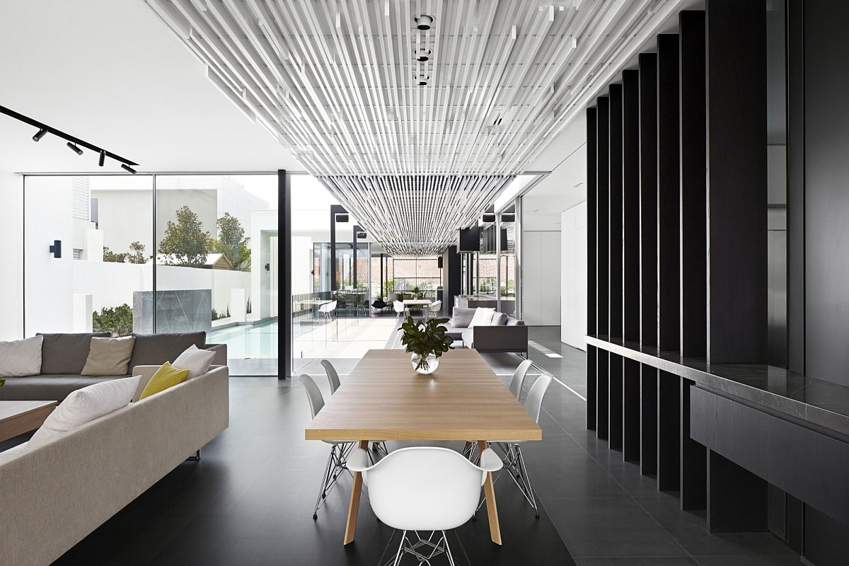 Open dining area of the Aussie home with a dark backdrop