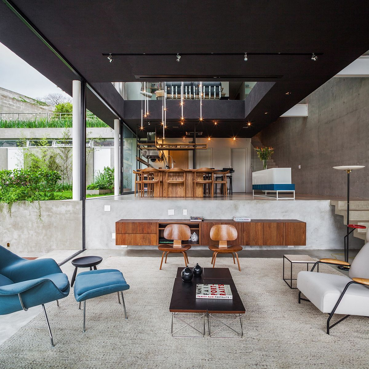 Open living area and dining of the Brazilian area Brazilian Modern: Poised Multi Level Family Home in Sao Paulo