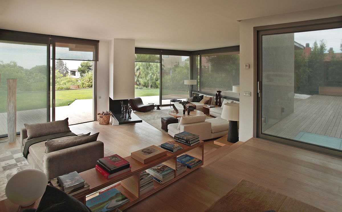 Open living area of the Barcelona home connected with the garden outside