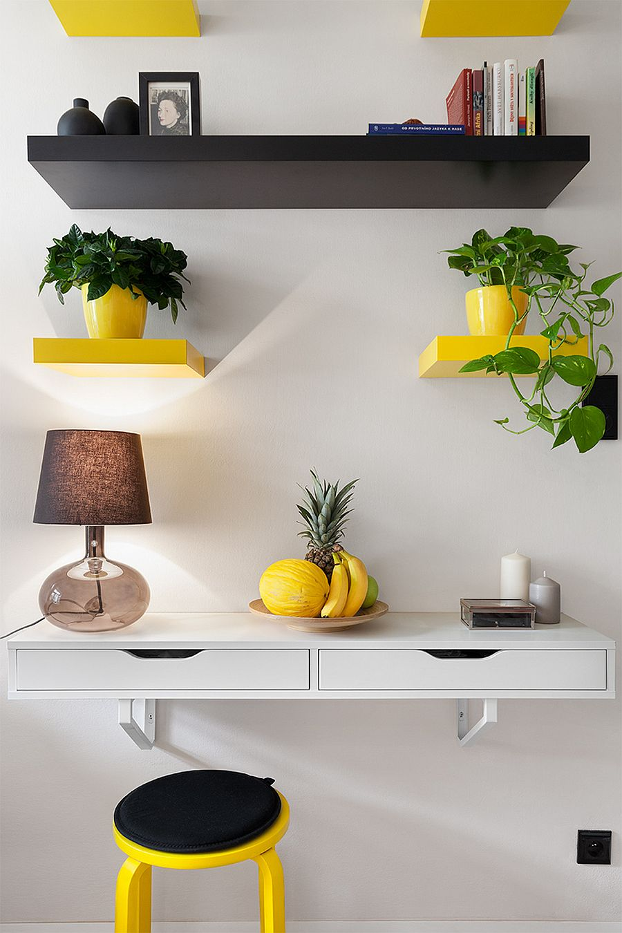 Pops of yellow stand out more vividly thanks to the neutral backdrop